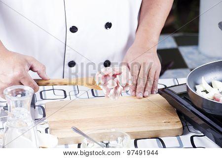 Chef Putting Slice Pf Pork To The Pan