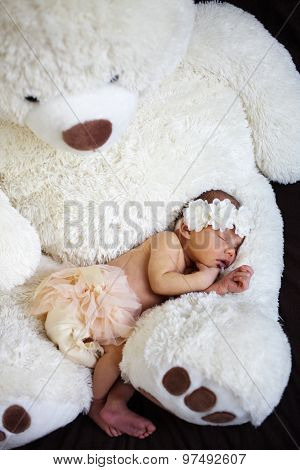 Newborn baby sleeping on white blanket