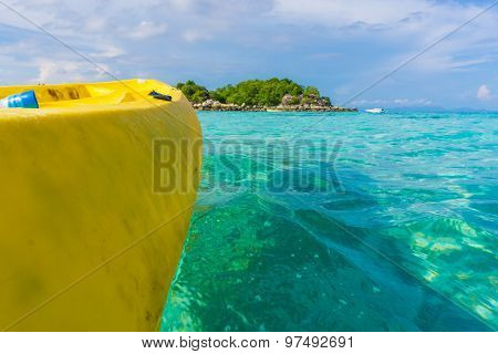 Paddling Yellow Kayak Into The Andaman Sea