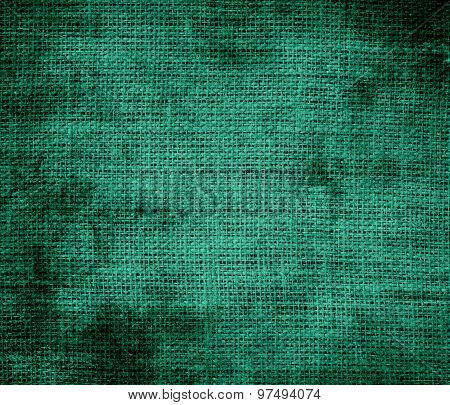 Grunge background of deep green-cyan turquoise burlap texture