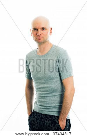 Man With Bald Head In Gray Shirt