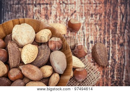 Mix Nuts In A Wooden Bowl Against Rustic Background
