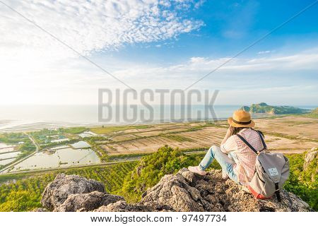 Hiker Woman With Camera Enjoy The View At Sunrise Mountain Peak Cliff