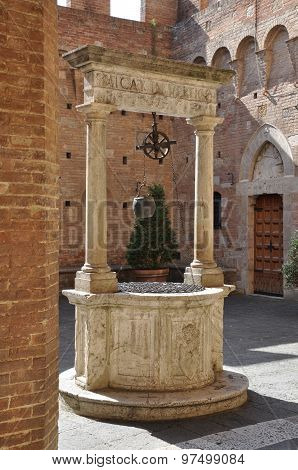 Old stone water well in Tuscany, Italy