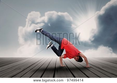 Dancing boy under clouds