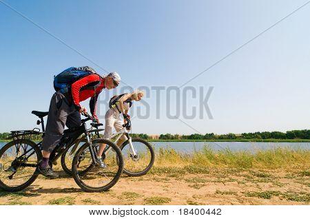 two cyclists biking outdoors