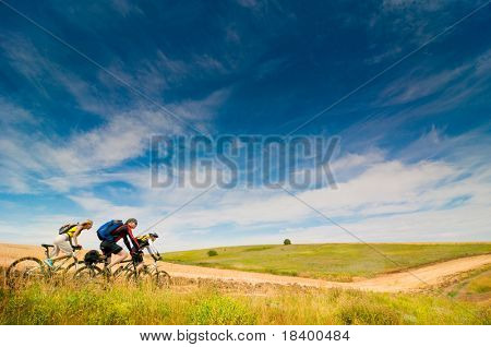 group of cyclists relax biking outdoors