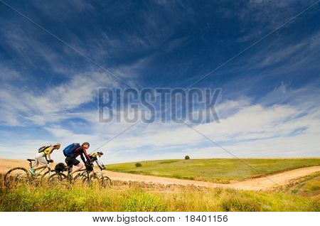 mixed group of cyclists relax biking outdoors