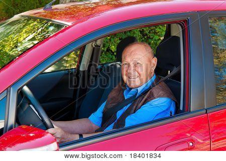 Senior as a car driver in the car
