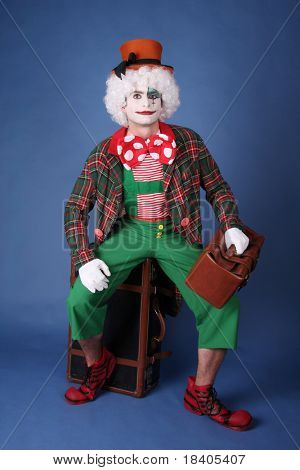 funny clown with white hair on blue background