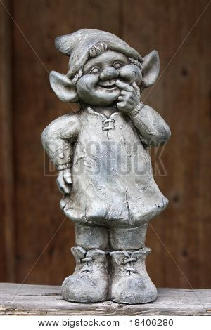 Funny dwarf, gnome with brown background