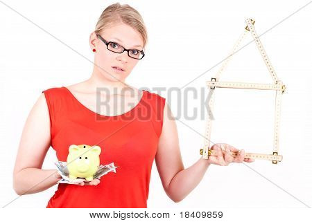 Young Woman With House Symbol And Piggy Bank