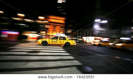 New York City taxi on a night street. Motion shot.