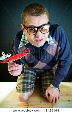 Funny nerd with a toy airplane