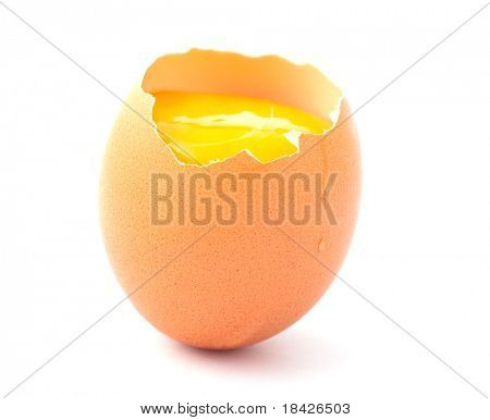 standing egg cracked open and showing yolk