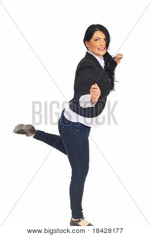 Cheerful Business Woman Standing In One Leg