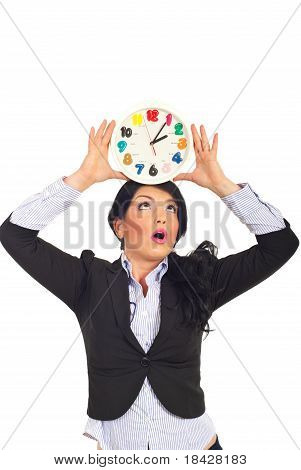 Surprised Woman Holding Clock Overhead