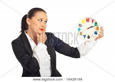 Thinking Business Woman Looking At Clock