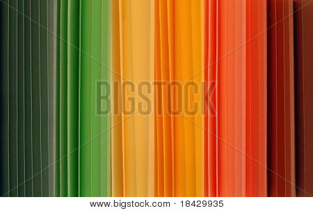 Spectrum of colors. Parallel vertical folded papers. These are window shutter samples.