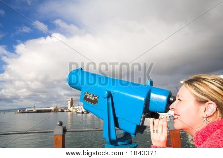 Tourist Using Telescope