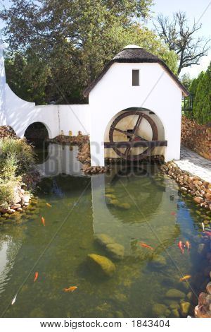 Old Refurbished Waterwheel And Watermill
