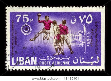 LEBANON-CIRCA 1973:A stamp printed in Lebanon shows image of the Handball is a team sport in which two teams of seven players each pass a ball to throw it into the goal of the other team, circa 1973.