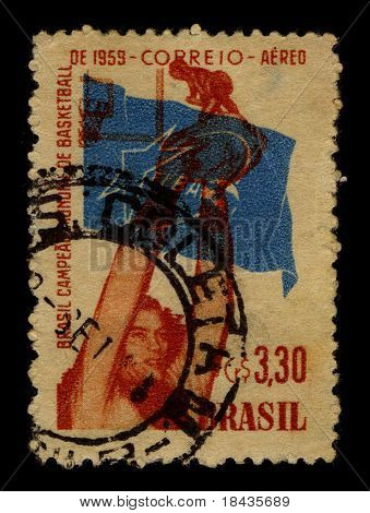 "BRAZIL - CIRCA 1959:A stamp printed in BRAZIL shows image of the Basketball is a team sport in which two teams of five players try to score points by throwing or ""shooting"", circa 19"