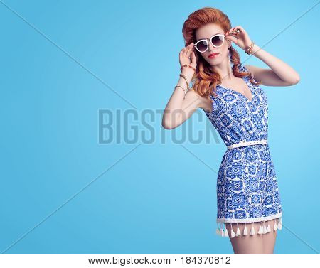 poster of Fashion Redhead Model in Sexy Jumpsuit, woman in Trendy Summer Dress. Stylish wavy hairstyle, fashion Sunglasses, Summer Floral Outfit. Glamour fashion pose. Playful Beauty Girl, Luxury summer Lady