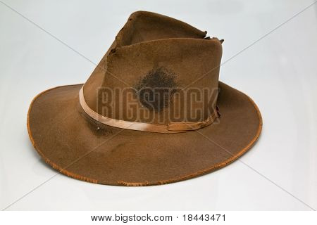 Old worn brown hat that is stained