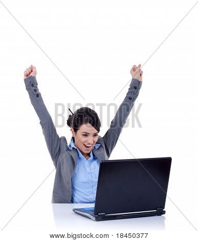 Young Woman In Office Jubilates At Desk