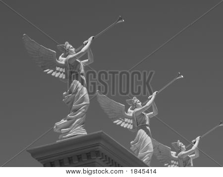 Angel Statues Blowing Trumpets