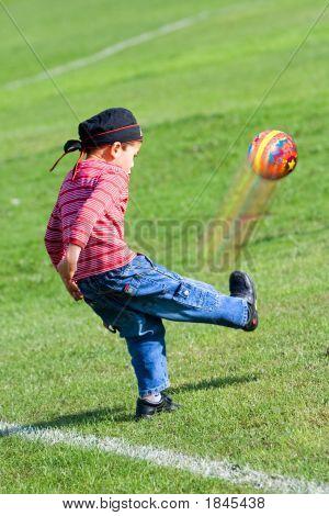 Kicking A Ball Fun In The Park.