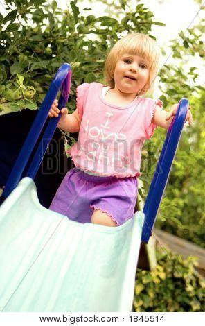 Toddler Girl Going Down Slide
