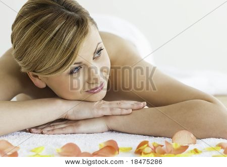 Young Blond-haired Woman Happy While Lying Down
