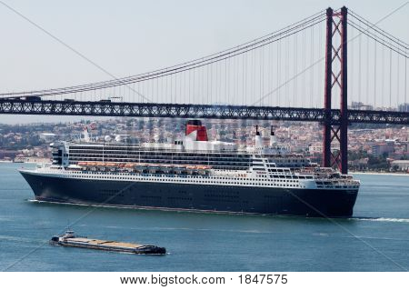 Luxurious Cruise Ship Under The Bridge