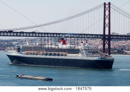 Luxurious Cruise Ship Under The Bridge