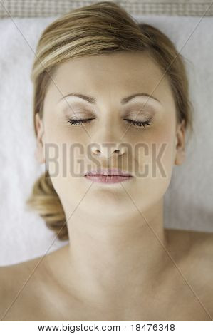 Young And Pretty Blond-haired Woman Lying Down