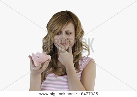 Blond-haired Woman Confused Concerning Her Broken Piggybank