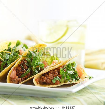 a platter of three beef tacos