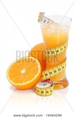 Fresh orange juice with measuring tape