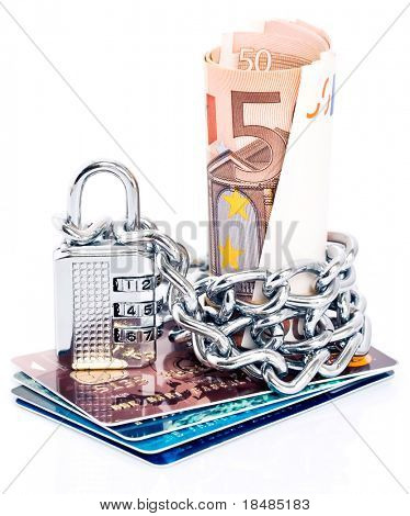 Padlock and chain around Euro currency on a stack of plastic credit cards isolated against a white background
