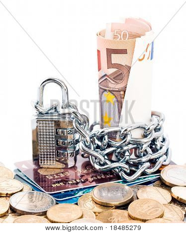 Padlock and chain around Euro currency on a stack of plastic credit cards and euro coins isolated against a white background.