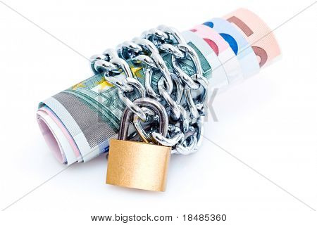 Curled stack of bank notes secured with padlock and chain, isolated on white background