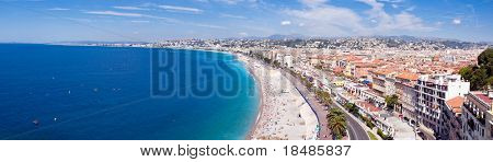 Panoramic view of city of Nice coastline and beach with blue sky and cloudscape background, France.