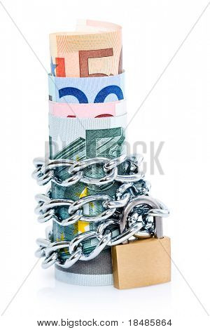 Curled stack of bank notes secured with padlock and chain, isolated on white background.