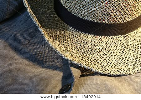 Closeup on a straw hat and suit