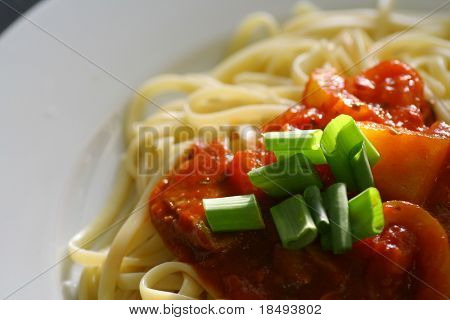 Plate of spaghetti with tomato sauce. Top view.
