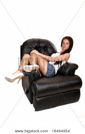 Girl Lying On Armchair.