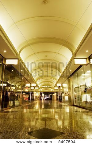Interior of shopping mall with tiled floor