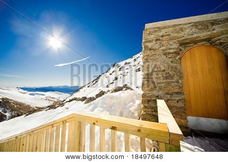 Doorway to remote cabin on a snow covered mountain